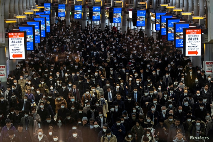 Crowds wearing protective masks, following an outbreak of the coronavirus, are seen at the Shinagawa station in Tokyo, Japan.