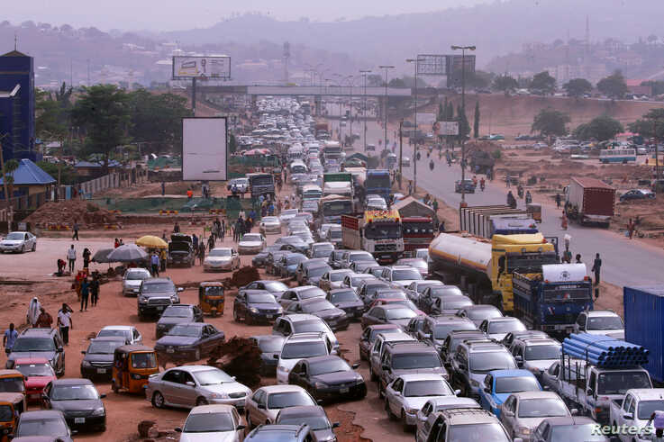 A traffic gridlock is seen as people attempt to rush out of Abuja, Nigeria, following efforts of the authorities trying to contain the spread of the coronavirus disease (COVID-19), March 30, 2020.
