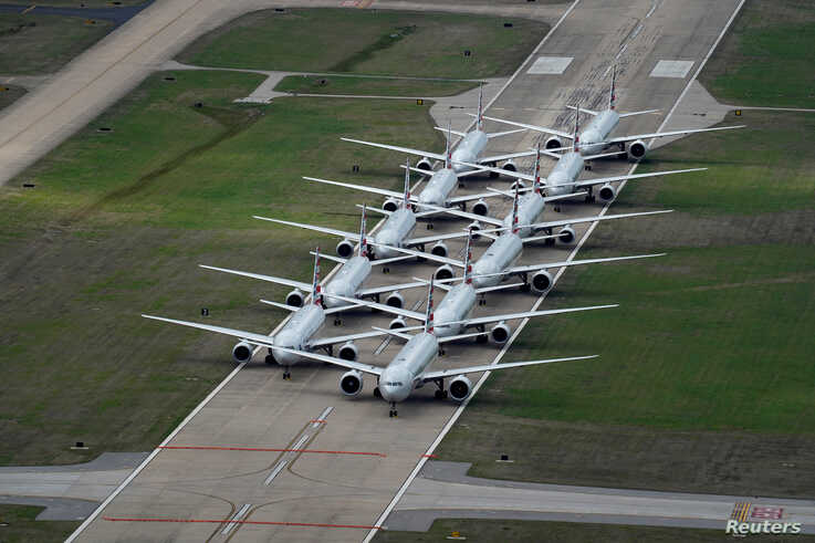 American Airlines passenger planes are parked on a runway due to flight reductions to slow the spread of coronavirus disease (COVID-19), at Tulsa International Airport in Tulsa, Oklahoma, March 23, 2020.