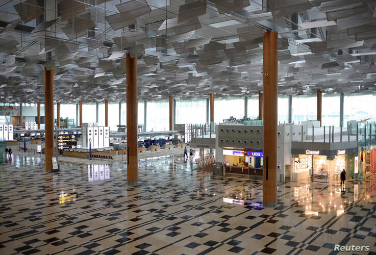 A view of an empty Changi Airport in Singapore, following the outbreak of the coronavirus disease (COVID-19), March 23, 2020.