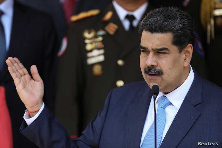 Venezuela's President Nicolas Maduro speaks during a news conference at Miraflores Palace in Caracas, March 12, 2020.