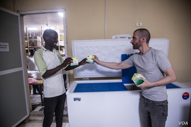 Eduardo Martins (R) oversees quality assurance operations in South Sudan for Continental Medical Supplies. (Chika Oduah/VOA)