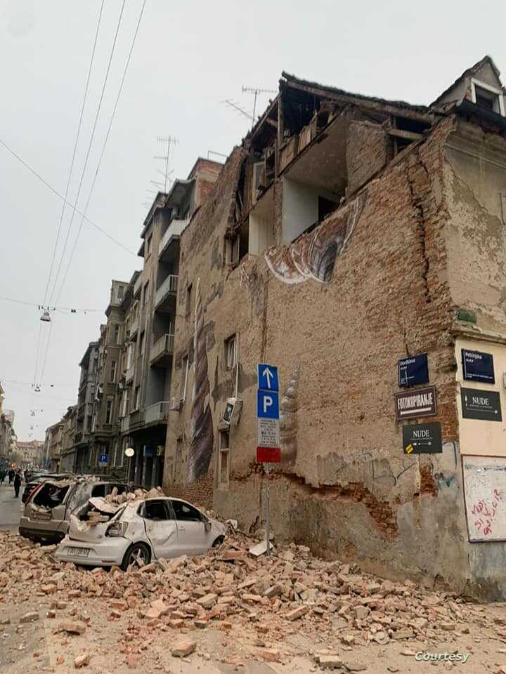 Cars are crushed by falling debris after an earthquake in Zagreb, Croatia, Sunday, March 22, 2020. (Courtesy Jan Pivac)