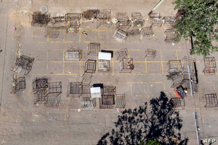 An aerial photo showing deserted vending stalls on the first day of a 21 day lockdown on March 30, 2020 in Bulawayo, Zimbabwe. …