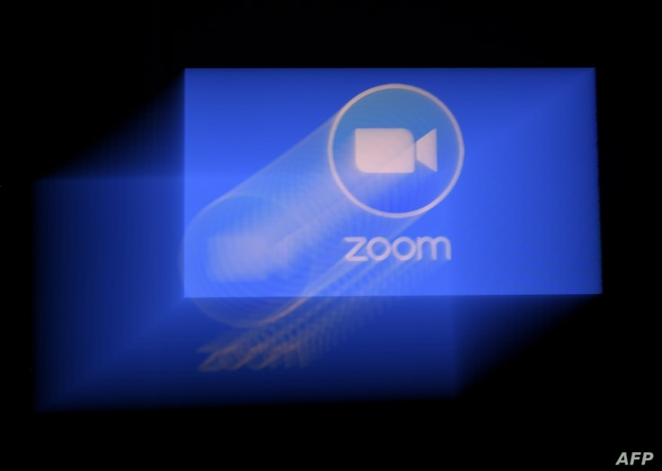 In this photo illustration a Zoom App logo is displayed on a smartphone on March 30, 2020 in Arlington, Virginia. - The Zoom…