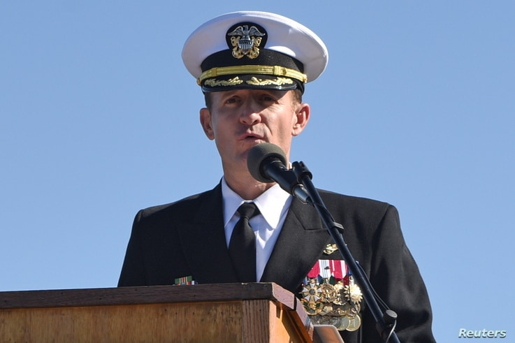 Captain Brett Crozier addresses the crew for the first time as commanding officer of the aircraft carrier USS Theodore Roosevelt in San Diego, California, March 1, 2020.