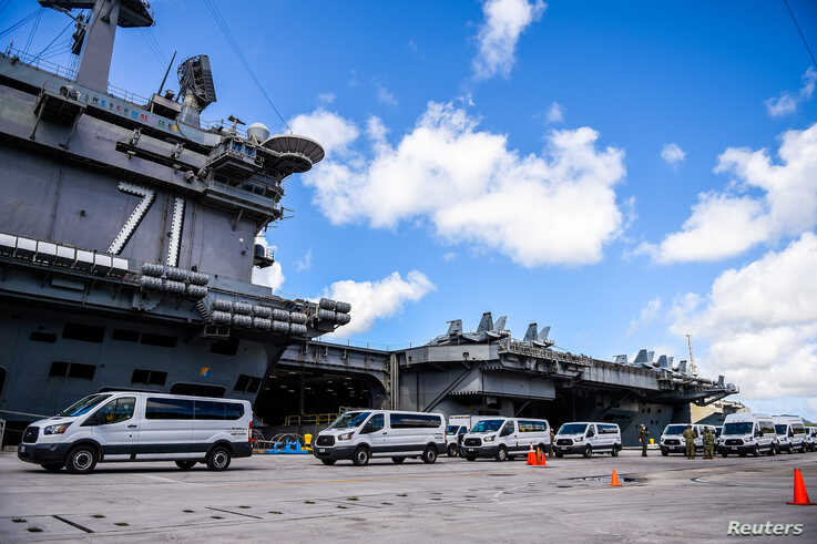 Seabees coordinate transportation of U.S. Navy sailors assigned to the aircraft carrier USS Theodore Roosevelt who have tested…