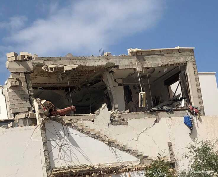 An apartment building after a bombing, March 27, 2020, in Tripoli, Libya.