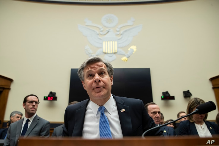 FBI Director Christopher Wray takes his seat to testify during an oversight hearing of the House Judiciary Committee, on…