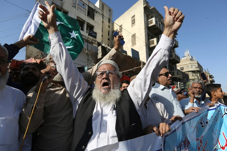 Pakistanis rally to express solidarity with Indian Kashmiris struggling for their independence, in Karachi, Pakistan, Wednesday…