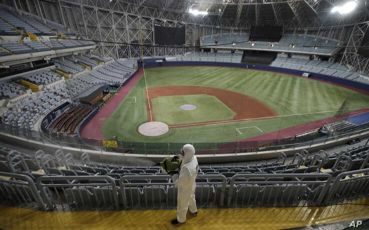 A worker wearing protective gears disinfects as a precaution against the new coronavirus at Gocheok Sky Dome in Seoul
