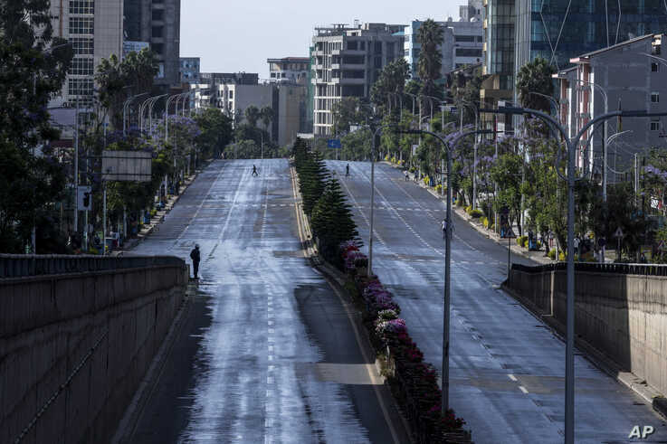 Roads in the capital lie empty after they were closed to be disinfected to halt the spread of the new coronavirus, in Addis…