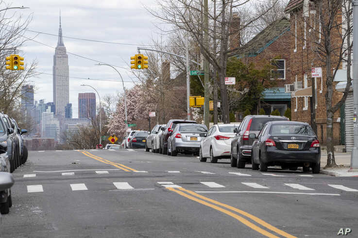 The Empire State building is seen in the distance from an empty street,  April 2, 2020, in the Brooklyn borough of New York.