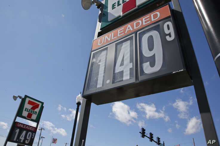FILE - Gas prices are listed for unleaded at a gas station in Oklahoma City.
