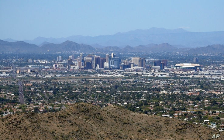 The downtown Phoenix skyline is easier to see, Tuesday, April 7, 2020, as fewer motorists in Arizona are driving, following the…