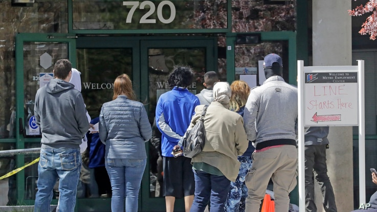 People line up outside the Utah Department of workforce Services Monday, April 13, 2020, in Salt Lake City. Congress, the Trump…