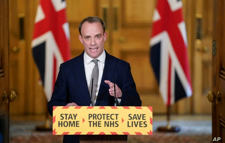 In this photo made available by 10 Downing Street, Britain's Foreign Secretary Dominic Raab gestures during a coronavirus media...