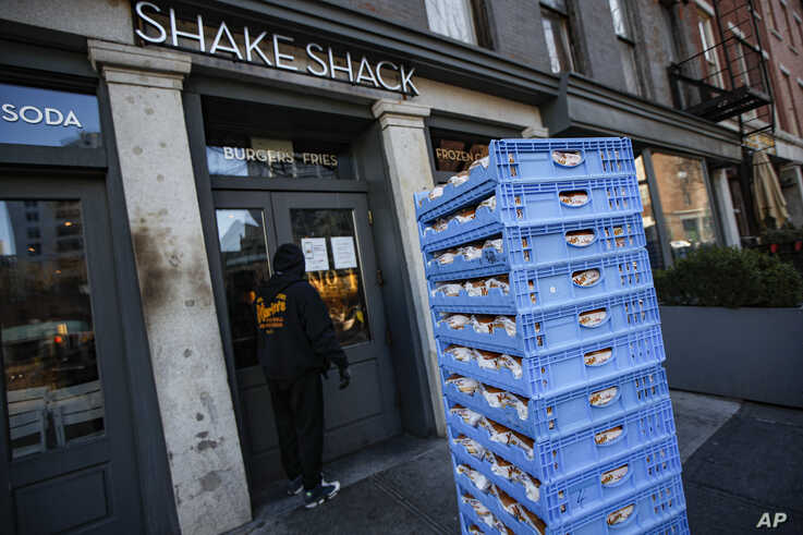 FILE - A bread delivery is made to a Shake Shack restaurant in the Brooklyn borough of New York, March 16, 2020.