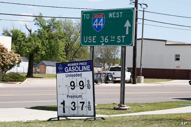 Gas prices are posted as .999 for regular and 1.37 for premium at a Sam's Club, Tuesday, April 21, 2020, in Oklahoma City, as…