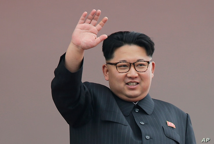 FILE -North Korean leader Kim Jong Un waves at parade participants at the Kim Il Sung Square n Pyongyang.