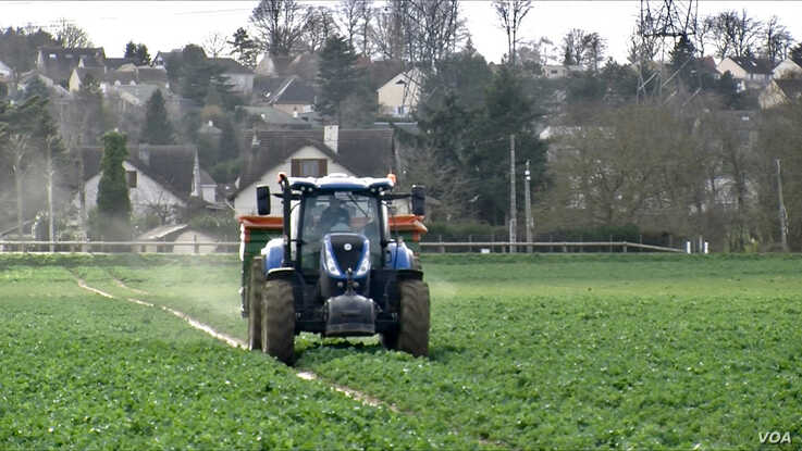 Cereal farmer Jerome Regnault in his tractor in Plaisir, outside of Paris. He says working in his business needs experience. (Lisa Bryant/VOA)