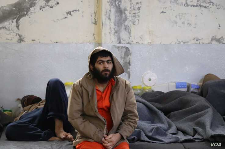 Thousands of foreign suspects who surrendered over a year ago as Islamic State lost its last territory are still being held with no formal charges or trials, Feb. 16, 2020 in Hasseka, Syria. (Heather Murdock/VOA)
