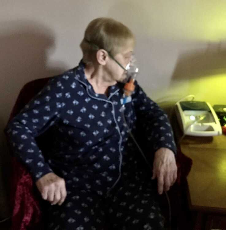 Connie Lambert resorts to oxygen from a portable tank in her bedroom when breathing becomes difficult.