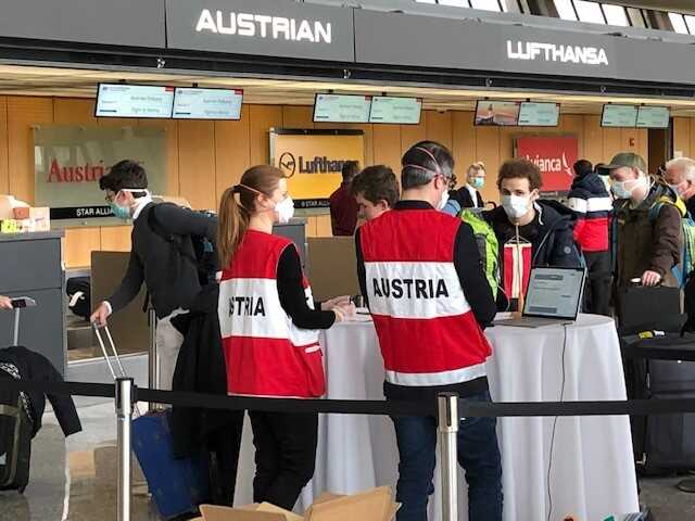 Austrians heading home get their papers checked on March 23rd, 2020 at Dulles Airport.