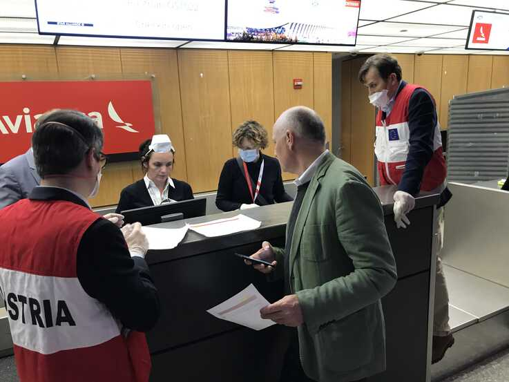 Martin Weiss, Ambassador of Austria to the U.S. (in green jacket) seen here at the Austrian Airlines ticket counter on March 23r