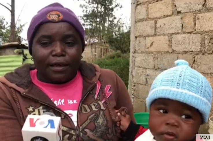 This woman, who is holding her baby tells VOA the locals are used to cool weather illnesses and have their own herbal concoctions to treat them. (Photo: Matiado Vilme / VOA)