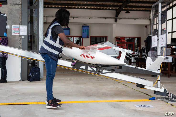 A staff member prepares a drone for the delivery of medical supplies at a service base run by operator Zipline, in Omenako, 70 kilometers north of Accra, Ghana, April 23, 2019.