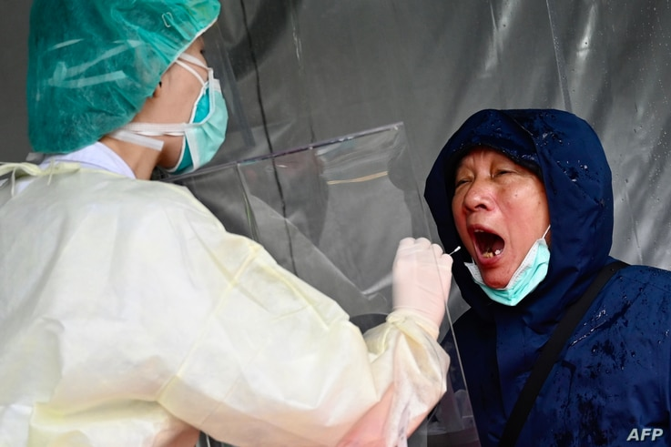 A medical staff collects a sample for testing during a drill organised by the New Taipei City government to prevent the spread of the COVID-19 coronavirus, in Xindian district, Taiwan, March 14, 2020.