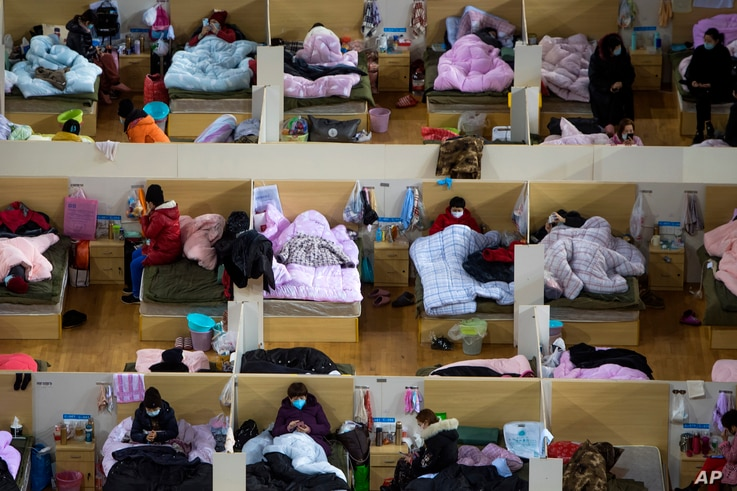 In this Feb. 17, 2020, photo released by Xinhua News Agency, patients infected with the coronavirus rest at a temporary hospital converted from Wuhan Sports Center in Wuhan in central China's Hubei Province.