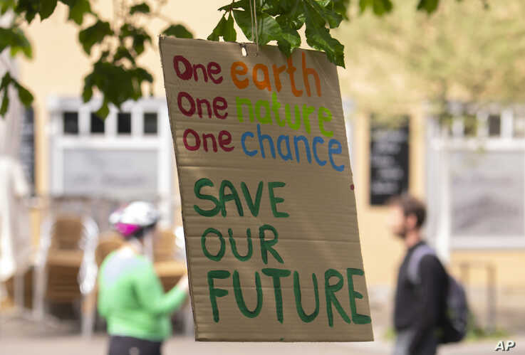 A sign hung by activists of the Fridays for Future movement is seen on a tree in Erfurt, Germany, April 24, 2020.