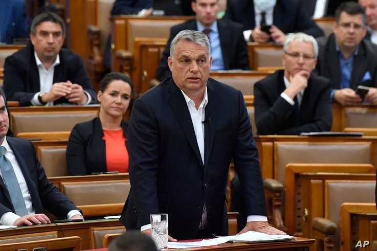 Hungarian Prime Minister Viktor Orban replies to an oppositional MP during a question and answer session of the Parliament in Budapest, Hungary, March 30, 2020.