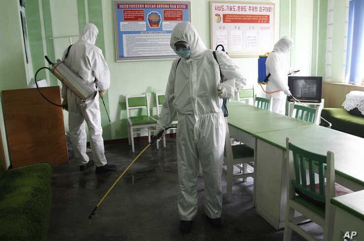 Offices at the Phyongchon District People's Hospital are disinfected, in Pyongyang, North Korea, April 1, 2020.