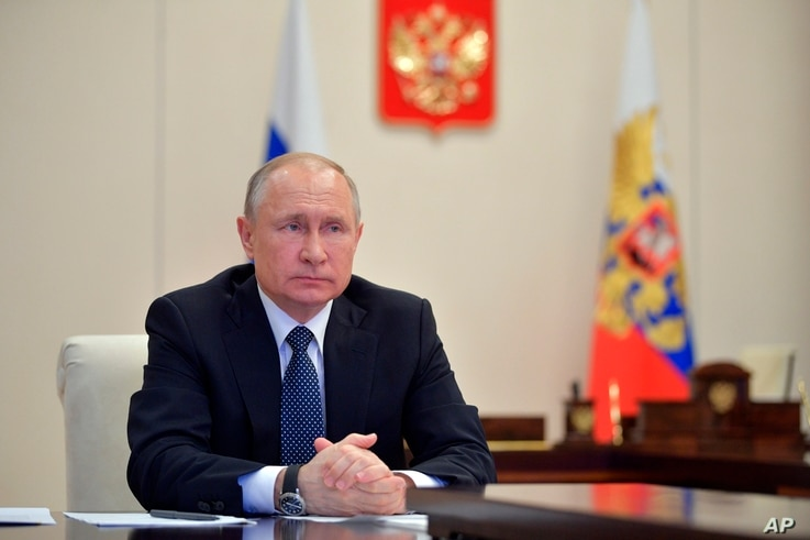 FILE - Russian President Vladimir Putin is seen during a meeting at the Novo-Ogaryovo residence outside Moscow, Russia, April 7, 2020.