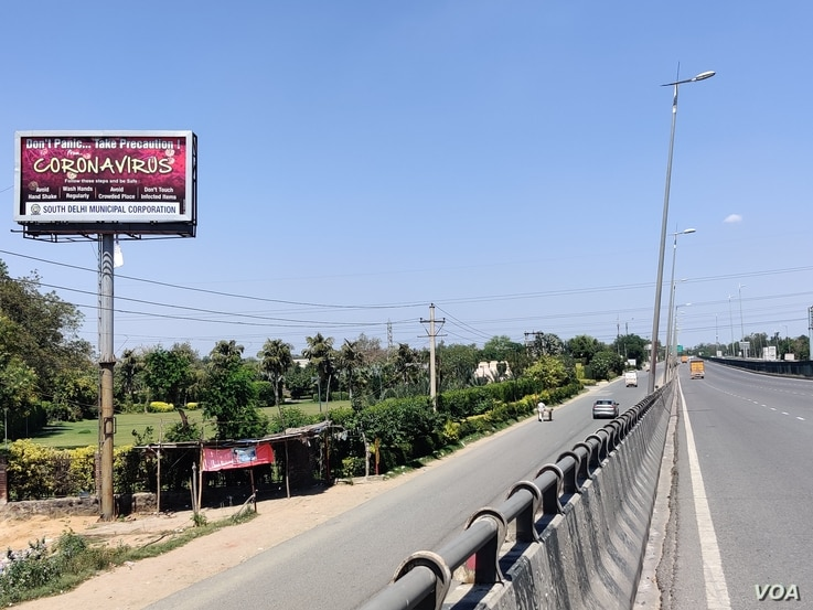 Glitzy roadside advertisements have given way to coronavirus messages. (Anjana Pasricha/VOA)
