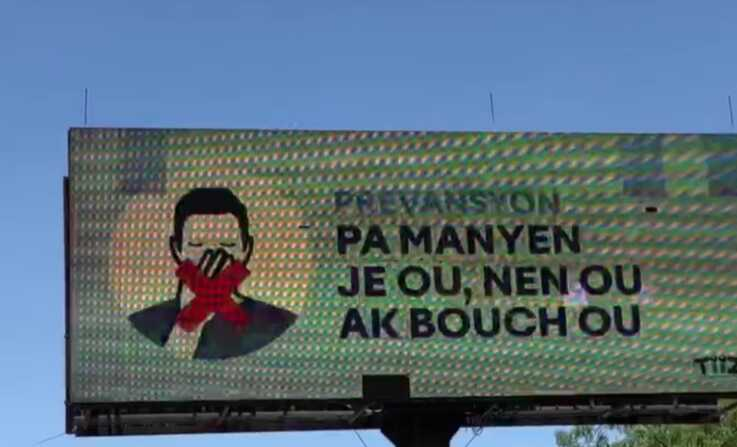 This coronavirus digital billboard in Haiti on April 1, 2020, advises people to avoid touching their eyes, nose and mouth.