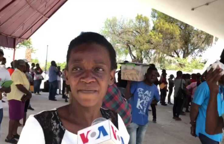 This woman standing in line for an ID card complains that the government breaks its own COVID-19 rules.