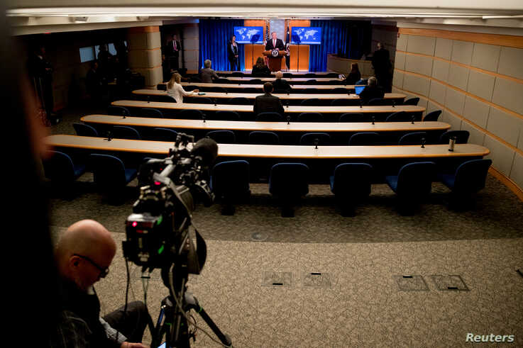 FILE - U.S. Secretary of State Mike Pompeo speaks at a news conference, which under coronavirus restrictions has only a handful of reporters and one pool camera in the room, at the State Department, in Washington, April 29, 2020.