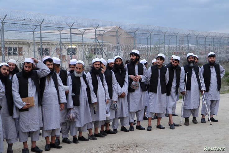 Newly freed Taliban prisoners line up at Bagram prison, north of Kabul, Afghanistan, April 11, 2020, in this photo provided by National Security Council of Afghanistan.