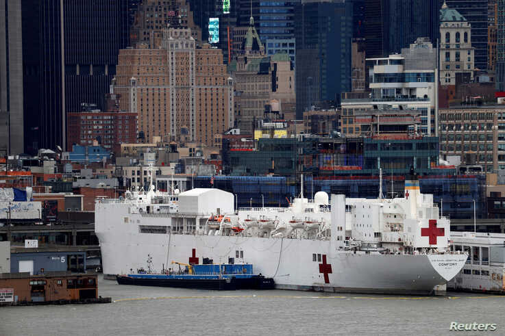 The USNS hospital ship Comfort is seen docked at Pier 90 on Manhattan's West Side during the outbreak of the coronavirus disease (COVID-19) in New York City, April 3, 2020.
