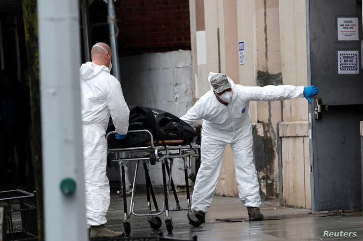 U.S. Army personnel remove the body of a deceased person from the The Riverside Premiere Rehabilitation & Healing Center senior facility on Manhattan's Upper West Side during the outbreak of the coronavirus disease in New York City, April 13, 2020.