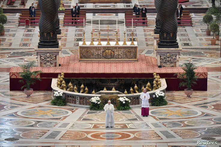 "Pope Francis reads his ""Urbi et Orbi"" (""To the City and the World"") message in St. Peter's Basilica with no public participation due to an outbreak of the coronavirus disease (COVID-19) on Easter Sunday at the Vatican."
