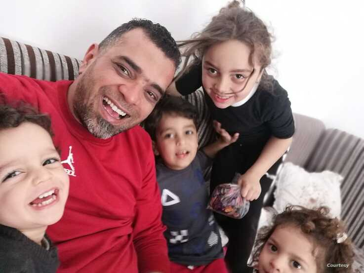 Wasef Gelani, 40, and his four children fled their home a year ago, and now they remain in a rented apartment hearing bombings everyday, March 23, 2020.