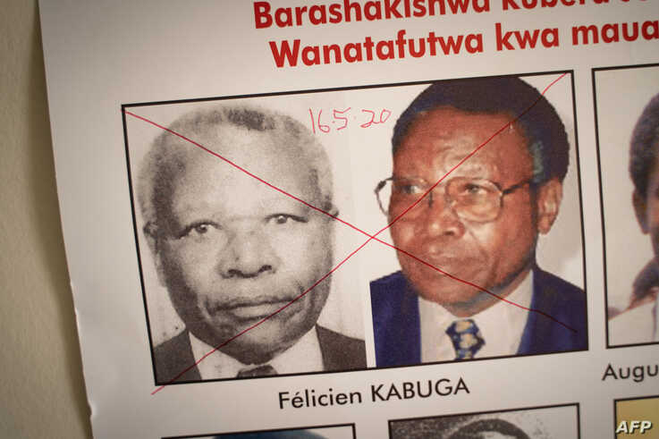 The date of arrest and a red cross are seen written on the face of Felicien Kabuga, one of the last key suspects in the 1994…