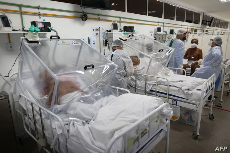 Health workers and patients remain in the Intensive Care Unit for COVID-19 of the Gilberto Novaes Hospital in Manaus, Brazil,…