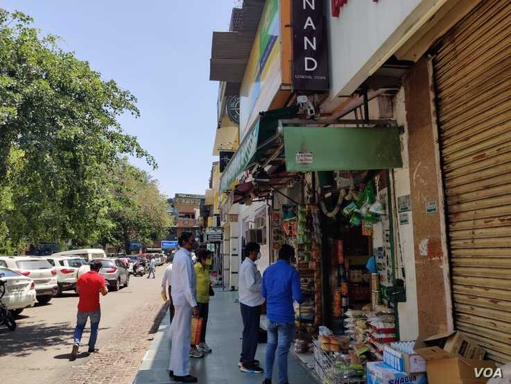 Most customers head to shops selling essentials like groceries and medicines. (Anjana Pasricha/VOA)