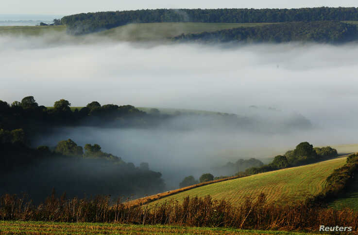 Autumn mists hang over villages and the countryside in the South Downs National Park near Amberley in Southern England